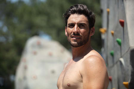 shirtless caucasian athletic crossfit man ready to climbing workout