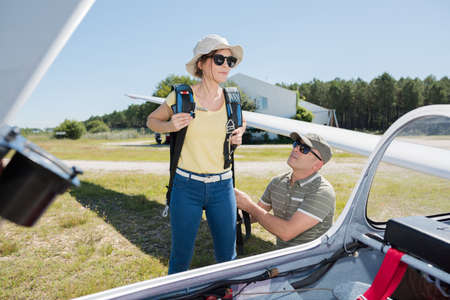 young woman going on board a glider