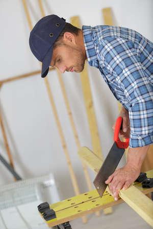 artisan carpenter using a manual saw Stok Fotoğraf