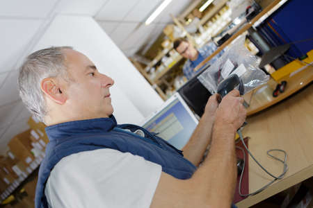 warehouse clerk scanning a product