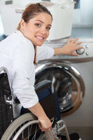 happy disable woman carring a basket to do laundry
