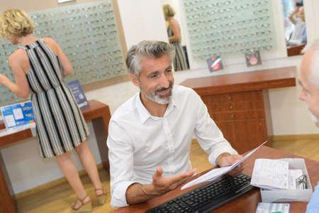 he is reading the eye prescription