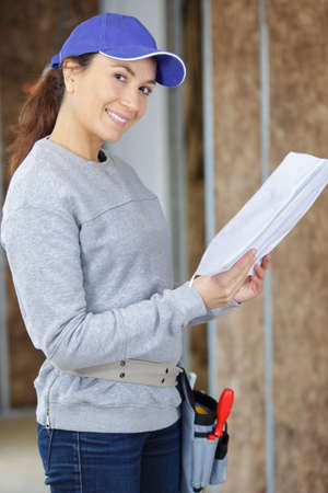 portrait of happy female architect in building area