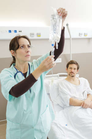 nurse preparing iv infusion in the hospital