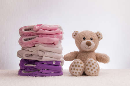 stack of organic diapers with a teddy bear