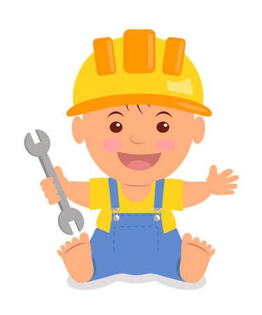 Toddler dans le casque de construction avec une clé dans sa main. enfant isolé dans un casque, T-shirt jaune et bleu de avec des bretelles.