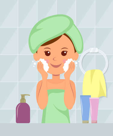 Beautiful girl with a towel on his head washes away makeup from the skin of her face foam. Taking care of your skin. Healthy lifestyle. Cosmetics.