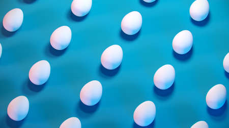 3d trendy easter blue pastel background pattern. Minimal fashion banner with white eggs, creative concept. 3d render. 3d illustration. 免版税图像