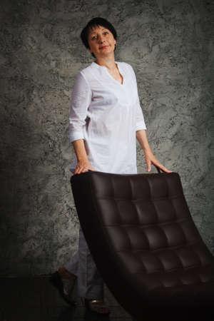 blackhead: Portret woman in white dress next to the chair Stock Photo