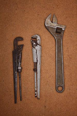 alligator wrench: Image set wrench on hardboard Stock Photo