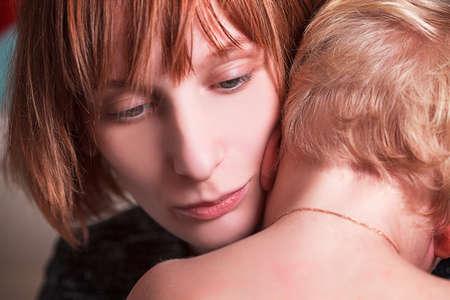 cuddles: Mother cuddles her son Stock Photo