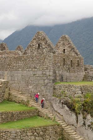 porch scene: Maccu PICCHU PERU - SEPTEMBER 26, 2015: Beautiful people visit Machu Picchu hidden city in Peru. Machu Picchu is a 15th-century Inca site in the Cusco Region.