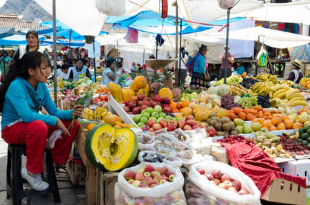 pisac: PISAC, PERU OCTOBER 6, 2015: Locals in a market in the city of Pisac in the Sacred Valley.