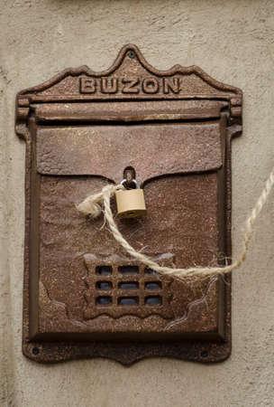 Vintage brown metallic mailbox on a wall
