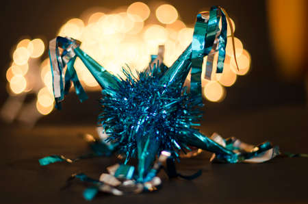 Blue pinata as decoration for Christmas and New Year on bokeh background