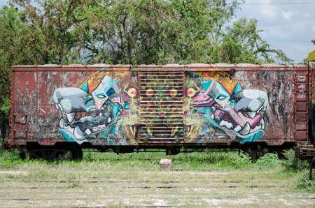 OAXACA, OAXACA, MEXICO- JUNE 1, 2018: Street art in an old rusty railway carriage in a sunny day at Ferrocarril Museum in Oaxaca, Mexico