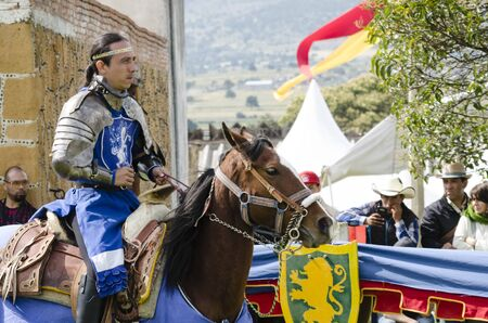 TLAXCALA, MEXICO-SEPTEMBER 29, 2018: Knight with blue clothing and armor riding a horse during Medieval Festival in Tlaxcala, Mexico