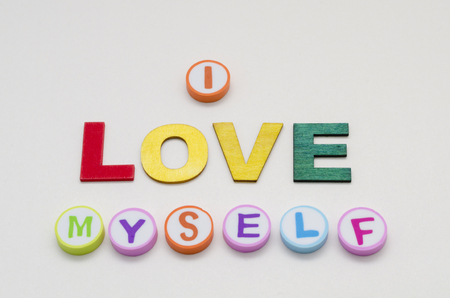 I love myself phrase made from colorful circles and letters against white background