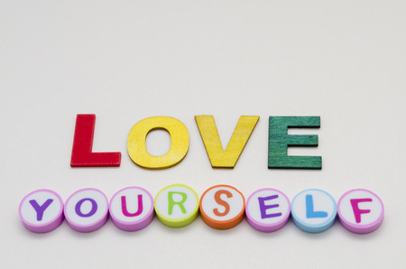 Love yourself phrase made from colorful circles and letters against white background Stock fotó