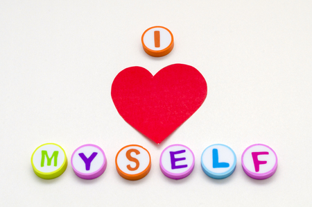 I love myself phrase made from colorful circles with letters against white background