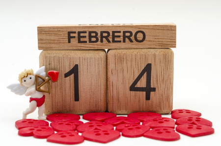 Calendar of rollover cubes with the date of February 14, a cupid and little red heart buttons against white background