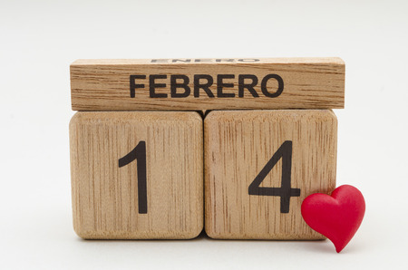 Calendar of rollover cubes with the date of February 14 and a little red heart against white background Stock Photo