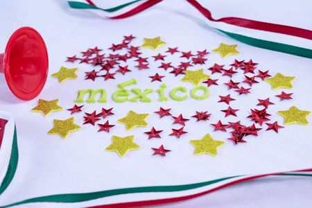 Trumpet, yellow and red stars and Mexico made from colorful letters on white background