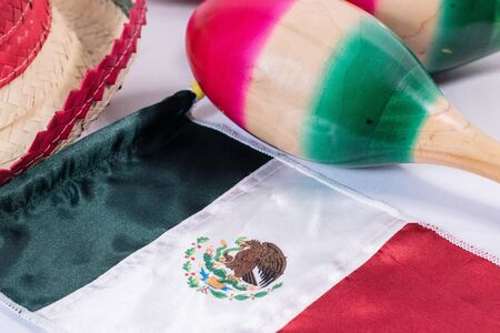 Hat, mexican flag and maracas on white background. Mexican Independence Day decoration