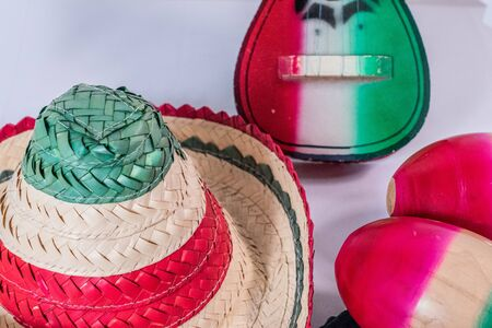 Hat, toy guitar and maracas on white background. Decoration for Mexican Independence Day