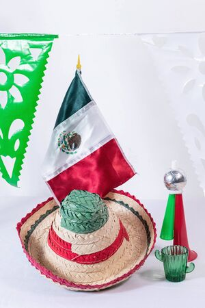 Little hat, cornet, mexican flag and glass of tequila on white background Stok Fotoğraf
