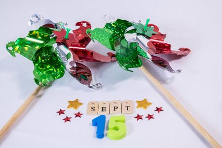 Pinwheels and september 15th made from wooden letters and colorful numbers on white background