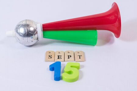 Cornet and september fifteenth made from wooden letters and colorful numbers on white background