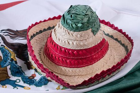 Little hat with a mexican flag as background. Accessories for Mexican Independence Day celebration