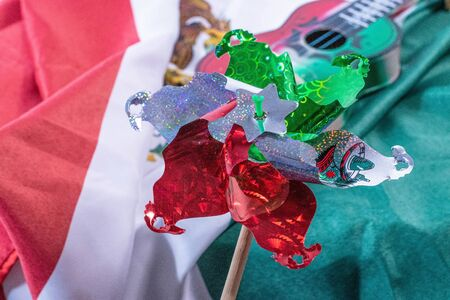 Pinwheel with a toy guitar and a mexican flag as background. Decoration for Mexican Independence Day celebration Stok Fotoğraf