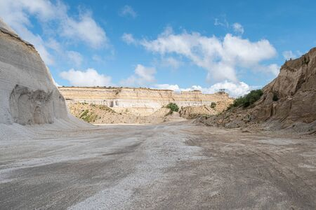 Sand quarry landscape with vivid blue sky and clouds at sunny day