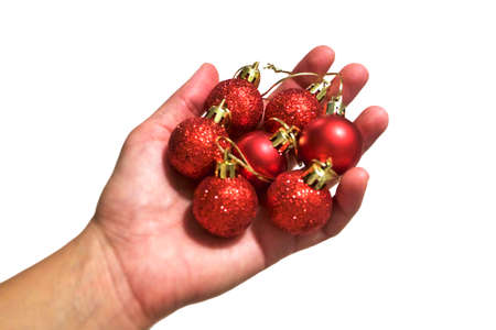 Red Christmas ornaments in hand