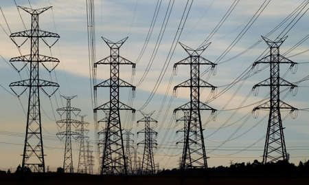 receding: A receding line of steel pylons supporting power transmission lines.