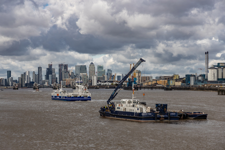 Boats on the River Thames and cityscape of London Editorial