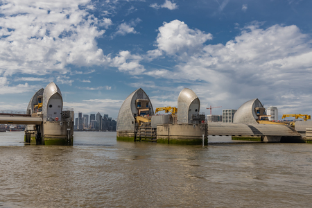 A view of the Thames Barrier from the East side showing the City of London between