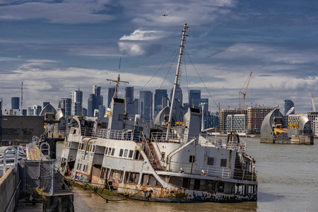 A derelict boat on the shore of the River Thames Editorial