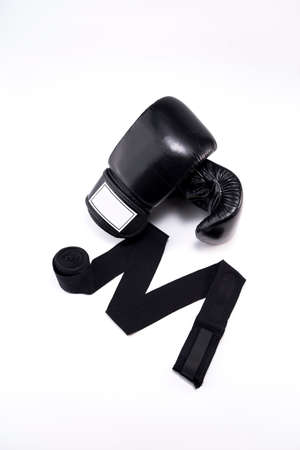footwork: Black Boxing Glove and Hand wrap on white background Stock Photo