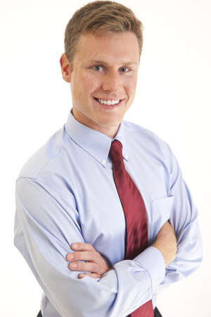 Portrait of smiling young businessman with arms folded Stock Photo - 7597982