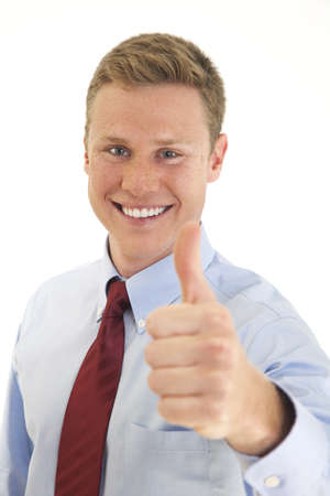 Smiling young businessman giving you a thumbs up