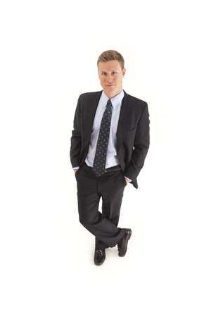 Portrait of smiling young businessman standing with hands in pockets Stock Photo - 7598165