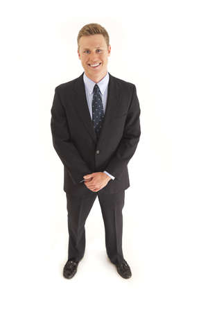 Portrait of smiling young businessman standing Stock Photo - 7598092
