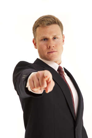 Young confident businessman pointing finger at camera photo