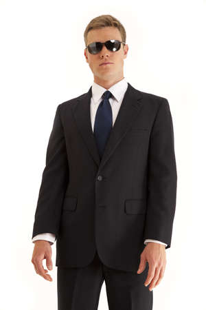 Confident young businessman wearing a suit and sunglasses Stock Photo
