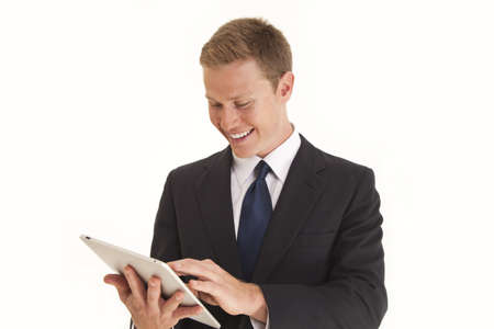 tablet: Young confident businessman using a touch screen tablet computer