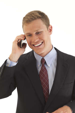 Young businessman talking on cell phone photo