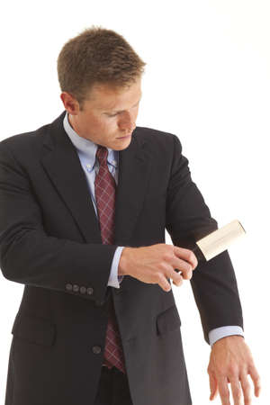 lint: Young businessman using lint brush